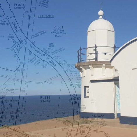Survey plan overlay on background of lighthouse building and ocean horizon